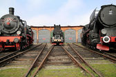 Three antique locomitives in the railway station — Stock Photo