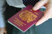 Handing over a UK passport — Stock Photo