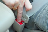 Unlocking seat belt — Stock Photo
