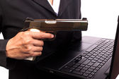 Close up of woman in business suit holding a gun back side — Stock Photo