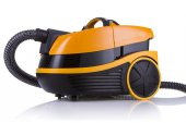 Orange vacuum cleaner on white background — Stock Photo