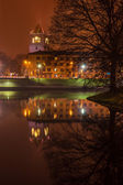 Bridge with reflection in the water at night — Stock Photo