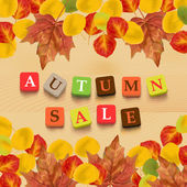 Autumn background with leaves and colorful letters. — Stock vektor