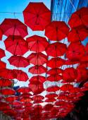 Red Umbrellas In the Air — Stock Photo