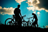 Cyclists on a hill — Stock Photo