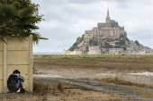 Graffiti on a fence and Mont Saint Michel — Stock Photo