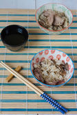 Chinese lunch set with rice and dusck meat, tea — Stock Photo