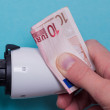 Постер, плакат: Radiator thermostat banknote and hand blue