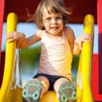 Girl on a slide — Stock Photo #69927701