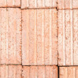 Red old bricks stacked in piles — Stock Photo #67750281