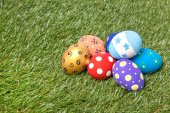 Pile of colorful handmade easter eggs on grass — Stock Photo