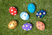 Colorful handmade easter eggs on green grass — Stock Photo