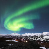 Northern lights above fjords in Iceland — Stock Photo