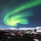 Northern lights above fjords in Iceland — Stok fotoğraf