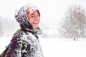 Portrait of an woman smiling at winter landscape — Stock Photo