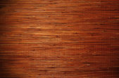 Bamboo brown straw mat as texture background. — Stock Photo
