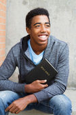 Teenager holding a Bible — Stock Photo