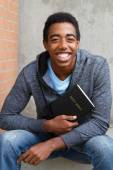 Teenager holding Bible — Stock Photo