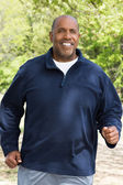 Mature African American man jogging — Stock Photo