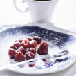 Fresh raspberries and a cup of coffee — Stock Photo #58420735
