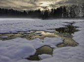 Snowy and flooded winter landscape — Stock Photo