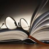 Reading glasses on the book — Stock Photo