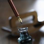 Ink with pen and ink blotter in background — Stock Photo