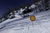 Winter landscape with snow covered road and traffic sign — Stock Photo