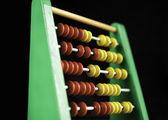 Abacus on black background — Stock Photo