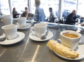 "Espresso coffee and a ""biscotti"" Italian cookie, in an Italian cafe in Montreal. — 图库照片"