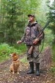 Man with dog out hunting for hazel grouse — Stock Photo