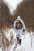 Hunter walking on the snowy glade — Foto Stock
