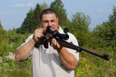 Hunter charges weapon — Stock Photo