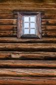 Window in a log wall — Stock Photo