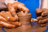Closeup of hands of potter teaching how make clay pot — Stock Photo