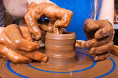 Potter teaches to sculpt in clay pot — Stock Photo