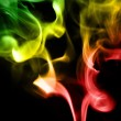 Colored smoke on a black background — Stock Photo #70004669