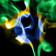 Colored smoke on a black background with brazilian flag — Stock Photo #70004687
