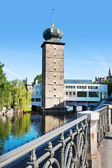 Sitkovska water tower and Manes gallery, Moldau river, Prague (U — Stock Photo