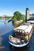 Sitkovska water tower and Manes gallery, Moldau river, Prague (U — Stock Photo
