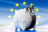 Savings in piggy bank - tighten the belt — Stock Photo