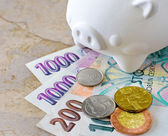 Czech crown banknotes and coins with piggy bank — Stock Photo