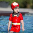 Little asian girl in the pool with swimming suit — Stock Photo #62652071