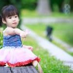 Little asian girl in the garden — Stock Photo #62798931