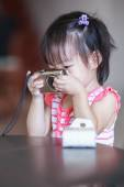 Little girl take a photo — Stock Photo