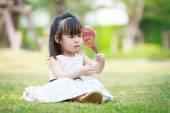 Little asian girl in the garden — Stock Photo