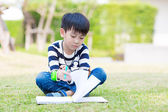 Little asian boy serious homework — Foto Stock