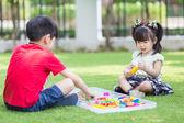 Brother and sister play sand — Zdjęcie stockowe