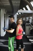 Fitness couple with free weight — Stock Photo