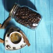 Coffee cup and coffee in boutle — Stock Photo #68560381